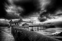 A storm brewing over Cromer pier in monochrome