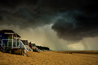 Storm over Wells beach huts